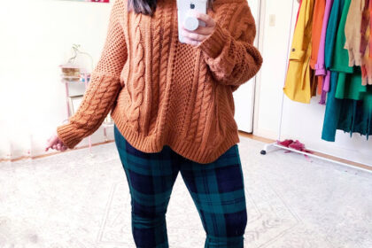 dina in green plaid pants and a brown sweater